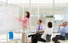 Woman at a whiteboard leading a focus group
