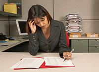 Pensive employee taking survey