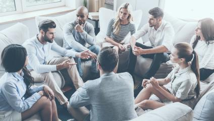 Leader meeting with employees in a small-group forum