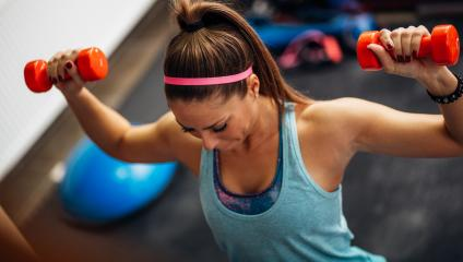 woman lifting weights - pump up meeting energy