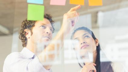 Employees working on communication presentation