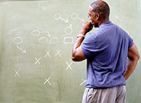 Coach reviewing strategy and tactics