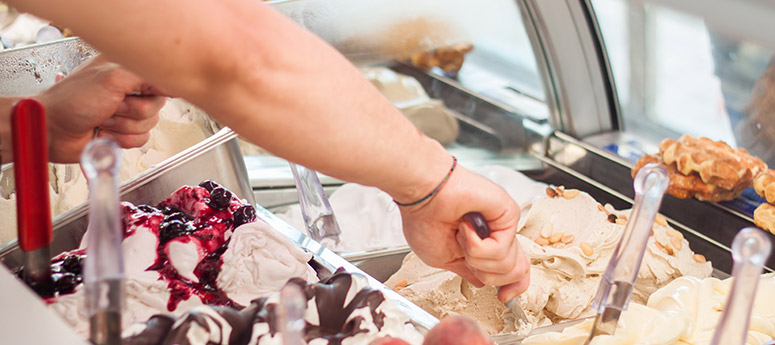 person scooping ice cream - get the scoop on how to promote adoption of social media