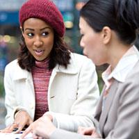 The baffler, asian woman talking to uncertain-looking AA woman