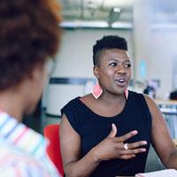 Rambler - AA woman talking to focus group